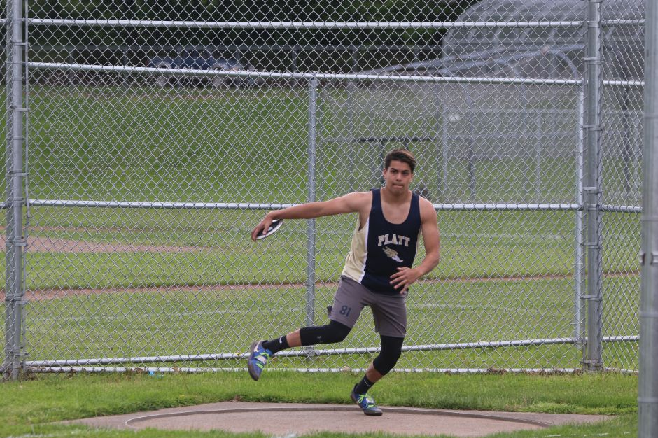 Platt thrower Julio Hernandez begins to throw the discus in a track meet against Maloney in Meriden. May 15th, 2019 | Spencer Davis, Record Journal
