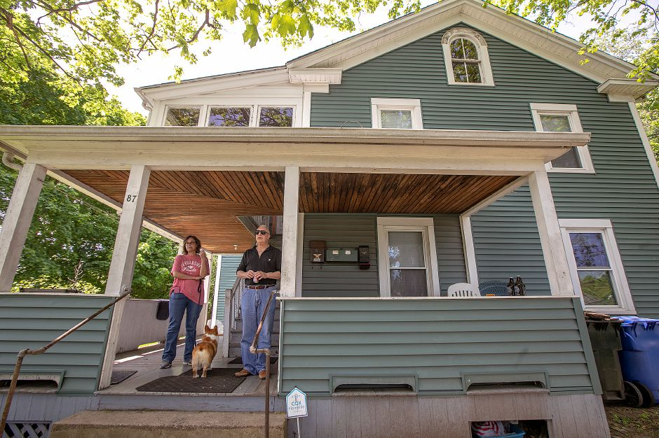 Meriden residents Elaine Scaglione and Joe Macri stand on the porch of their Cherry Street residence, Wed., May 22, 2019. Both have concerns over the wayside horn at the Cooper Street train crossing about 60 yards away. Dave Zajac, Record-Journal