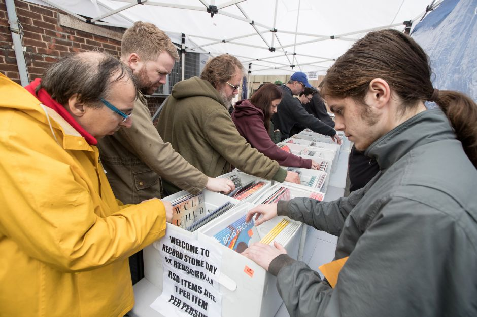 Vinyl hunters search through bins of records Saturday during Record Store Day at Red Scroll Records in Wallingford April 13, 2019 | Justin Weekes / Special to the Record-Journal