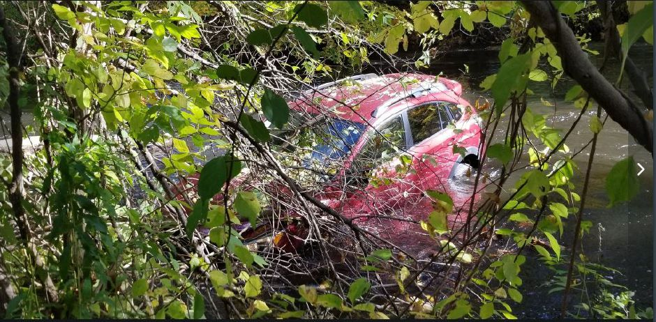 A vehicle went down an embankment into the Quinnipiac River on Friday. No injuries were reported. | Jeniece Roman, Record-Journal staff