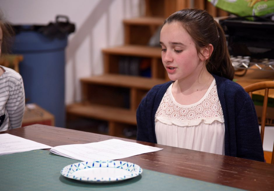 Fourth-grader Madelyn Ventola of Durham, reads lines with her Odyssey of the Mind team during a practice on April 30, 2019 in Middlefield. The team will compete in the Odyssey of the Mind world competition in Michigan later this month. | Bailey Wright, Record-Journal