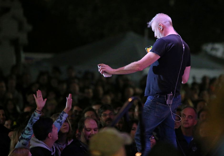 Spin Doctors lead singer Chris Barron returns a cellphone to a fan in the crowd during the concert on the main stage at the annual Apple Harvest Festival in Southington on Saturday. Emily J. Tilley, special to the Record-Journal.