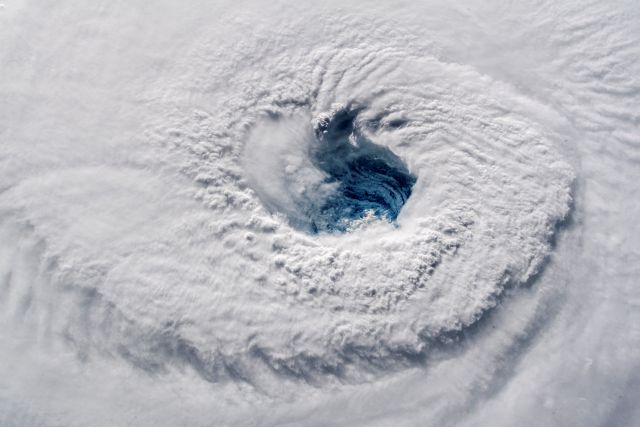 "In this Sept. 12, 2018 photo provided by NASA, Hurricane Florence churns over the Atlantic Ocean heading for the U.S. east coast as seen from the International Space Station. Astronaut Alexander Gerst, who shot the photo, tweeted: ""Ever stared down the gaping eye of a category 4 hurricane? It"
