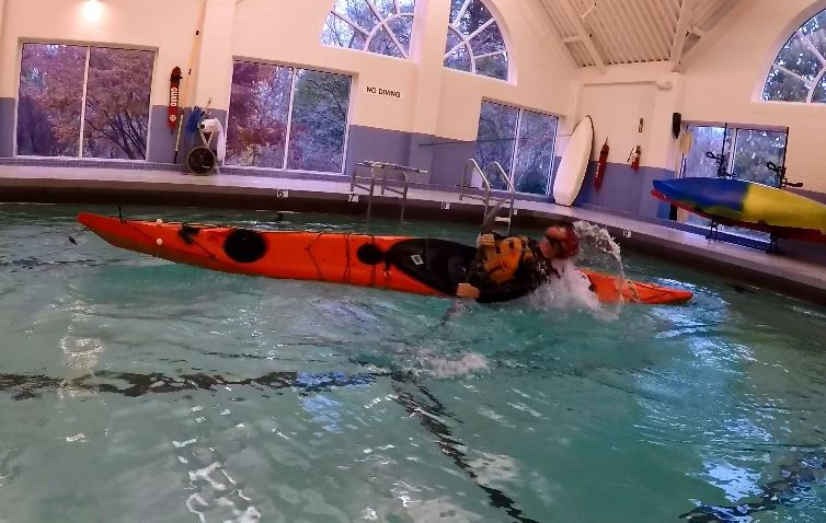 Kayak instructor Brian Cooper flips his kayak while practicing in the pool at Gaylord Hospital Sports Association, 50 Gaylord Farm Rd., Wallingford. Friday, Nov. 9. |Ashley Kus, Record-Journal