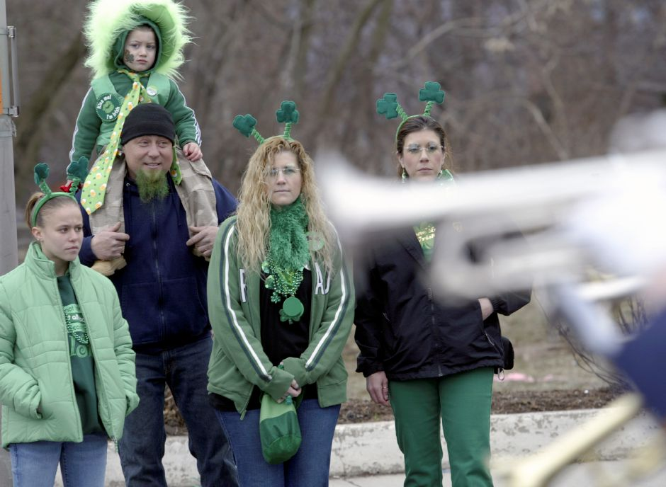 MERIDEN, Connecticut - Saturday, March 15, 2008 - From left, Tesla Nadwairski 15, Bob Nadwairski, Bob Jr. 3, on shoulders, Jen Otfinoski and Tracy Gratta watch as Platt High School Marching Band passes by during the 35th Annual Meriden AOH Saint Patrick