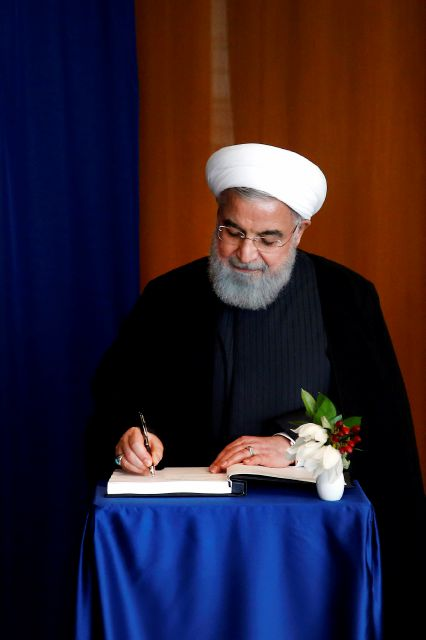 Iranian President Hassan Rouhani signs the guest book as he meets with United Nations Secretary General Antonio Guterres on the sidelines of the 73rd session of the United Nations General Assembly, at U.N. headquarters, Wednesday, Sept. 26, 2018. (AP Photo/Jason DeCrow)
