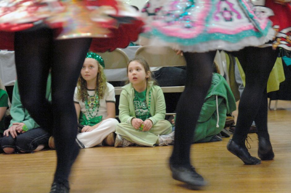 MERIDEN, Connecticut - Tuesday, March 17, 2009 - Brianna Fitzpatrick 9, left, and Jenna Messina 7, watch the Horgan Academy of Irish Dancers perform at the AOH Hall for the annual St. Patrick