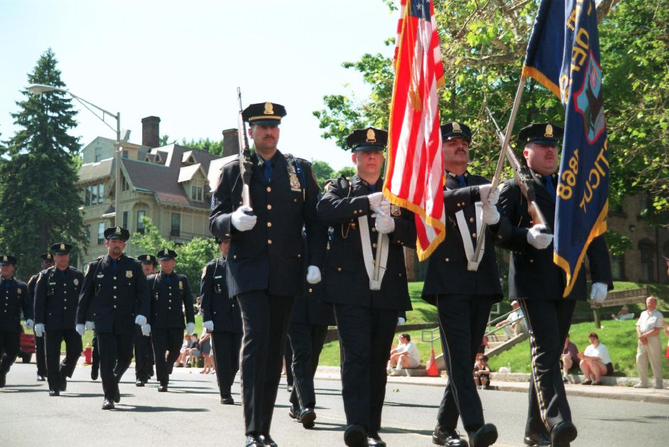 RJ file photo - The Meriden Police Dept. Honor Guard martches by during Meriden