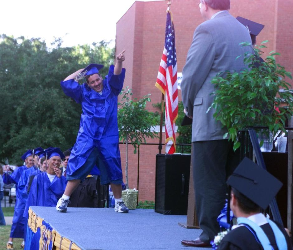 RJ file photo - Seth Kreck, of the Hotel Technology class, does a little dance before accepting his diploma at Wilcox Tech Fri., June 18, 1999.