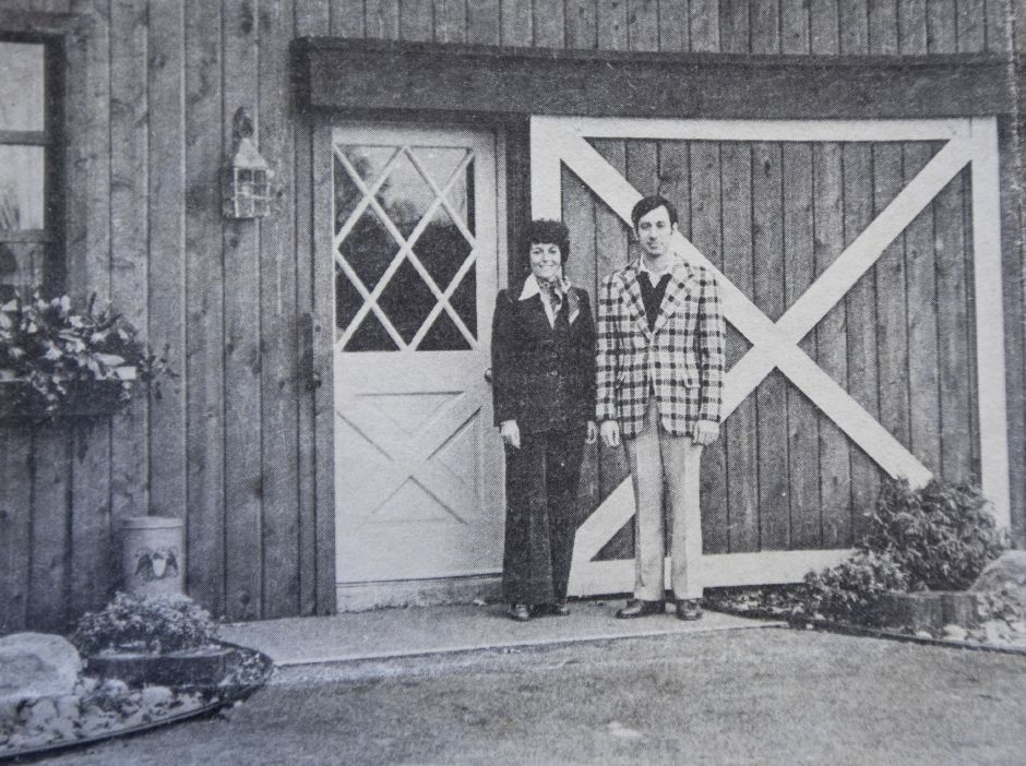 Fred and Sylvia Reich stand in front of their Cheshire business in 1975. Cheshire Herald Photo