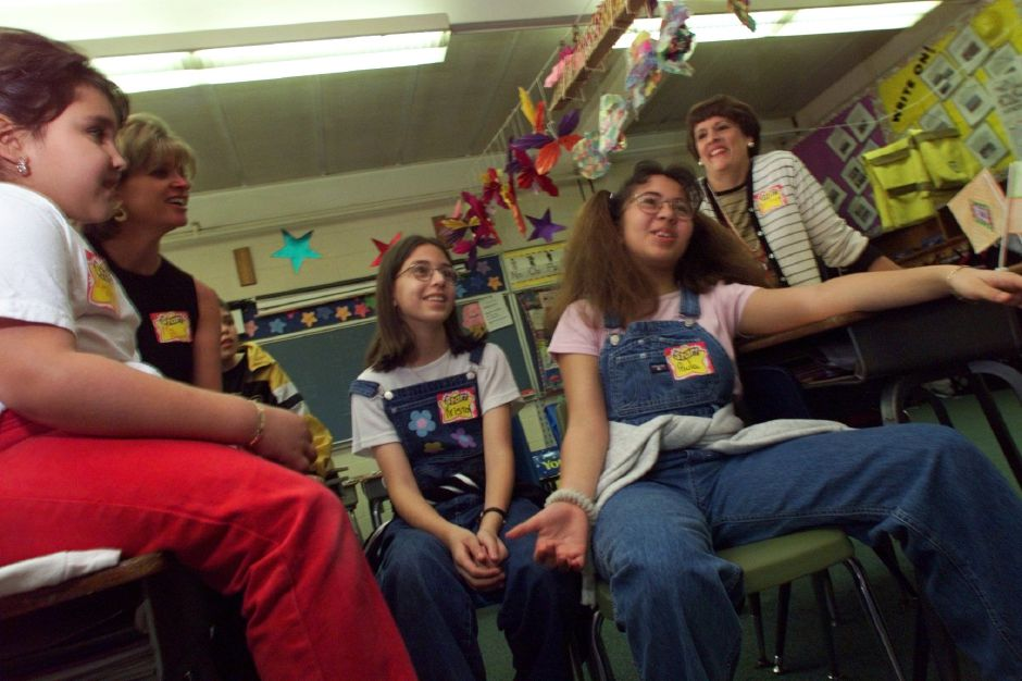 RJ file photo - Virginia Torres, 6, far left, Kristal Theron, 12, center, and Paula Suarez, 11, second from right, share their experiences with Wintergreen third graders, May 1999.