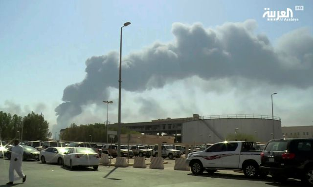 FILE - In this Saturday, Sept. 14, 2019 file photo, made from a video broadcast on the Saudi-owned Al-Arabiya satellite news channel, smoke from a fire at the Abqaiq oil processing facility fills the skyline, in Buqyaq, Saudi Arabia. The weekend drone attack on one of the world's largest crude oil processing plants that dramatically cut into global oil supplies is the most visible sign yet of how Aramco's stability and security is directly linked to that of its owner -- the Saudi...