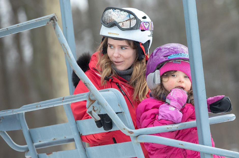 Quinnipiac University student Ashley Palmer rides the chairlift with Madison Hanson, 7, of East Hartford, during Skiers Unlimited at Mount Southington, Fri., Feb. 15, 2019. Dave Zajac, Record-Journal