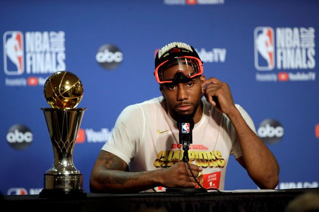 Toronto Raptors forward Kawhi Leonard speaks at a news conference alongside the NBA Finals Most Valuable Player trophy after the Raptors defeated the Golden State Warriors in Game 6 of basketball
