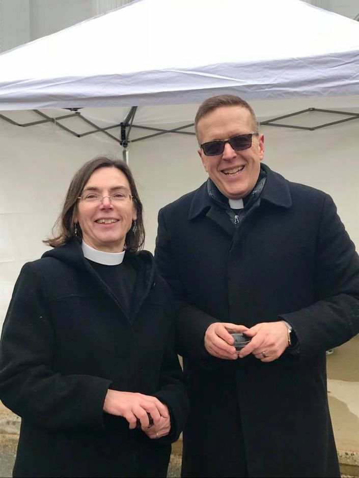 "Senior Minister James Campbell and Associate Minister Alison McCaffrey stand outside First Congregational Church of Cheshire, which offered ""Ashes on the Way"" to people wanting to observe Ash Wednesday, but unable to attend a service.Courtesy Joyce Mulholland, First Congregational"