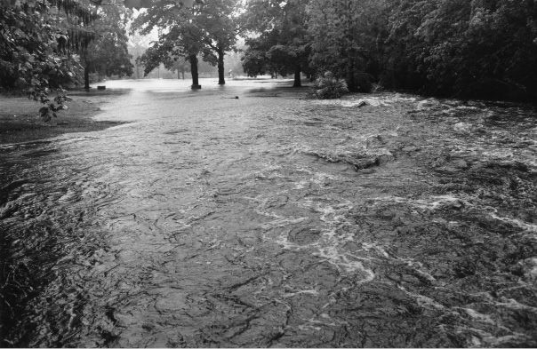 File photo - Brookside Park under water from a raging Harbor Brook as seen from Broad Street June 6, 1992.