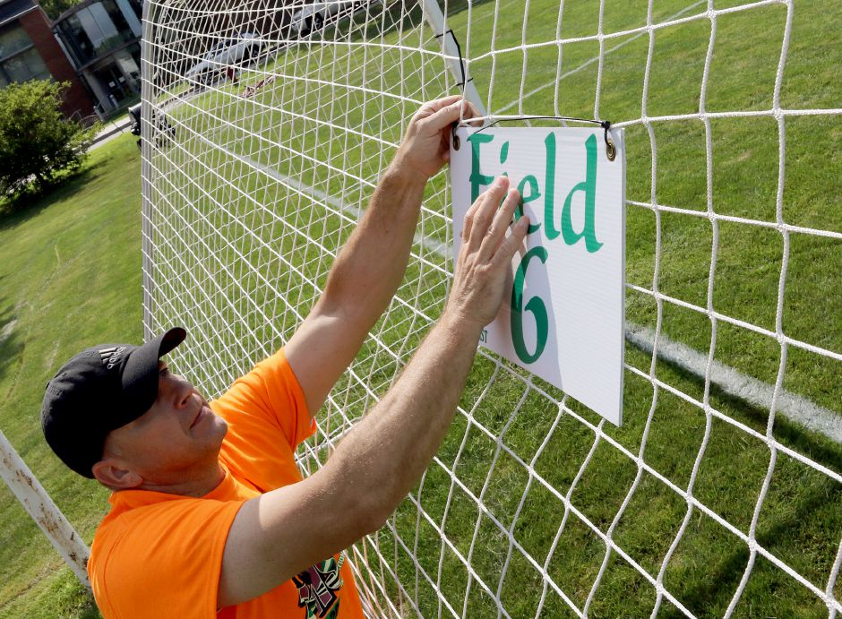 Sean Stowik gets the sign up for Field 6 at Choate Rosemary Hall during preparation for the 35th annual TWIST soccer tournament on Friday. Aaron Flaum, Record-Journal