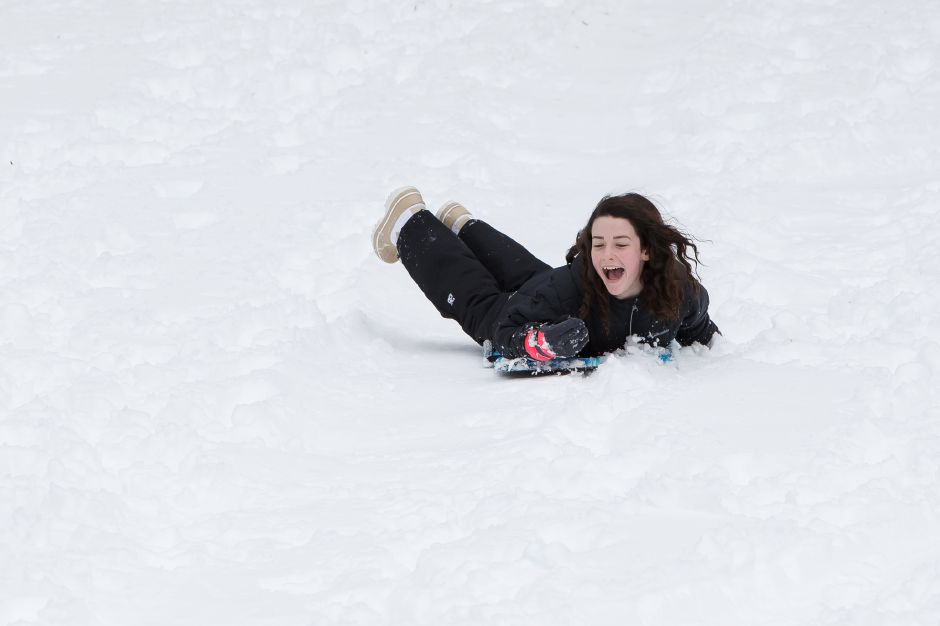 Rachel Worboys, 11, of Meriden, enjoys sliding in Hubbard Park Thursday after school was canceled because of the winter storm.  Photos by Justin Weekes, Special to the Record-Journal