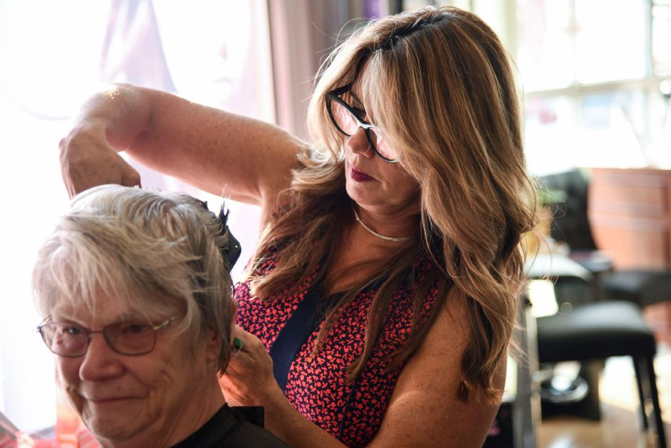 Sandy Derbacher, a breast cancer survivor from East Haven, gets her hair cut by North Haven salon owner Joyce-Lyn Altieri, on Wednesday, Oct. 10, 2018 at Flair for Hair. The salon is offering complimentary hair treatments for cancer survivors through the month of October and will have their 20th annual Cutting for a Cure event on Oct. 28. | Bailey Wright, Record-Journal
