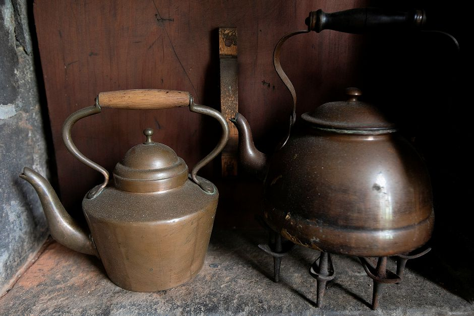 Tea kettles next to the hearth at the 1711 Solomon Goffe House, 677 N. Colony St. Meriden, Mon., May 6, 2019. The English Gambrel roofed house is the oldest in Meriden and listed on the National Register of Historic Places. Dave Zajac, Record-Journal