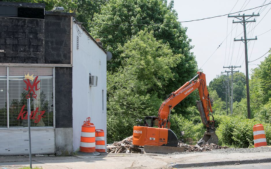 Crews continue demolition of the former Bradley Diner on West Main Street in Meriden, Friday, May 25, 2018. The building was razed to make way for rebuilding the Sodom Brook Bridge on West Main Street. Dave Zajac, Record-Journal