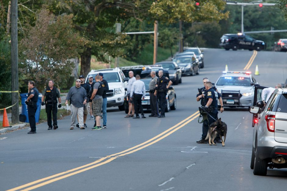 Meriden and State Police investigate a shooting at 75 Curtis Street in Meriden Wednesday October 10, 2018 | Justin Weekes / Special to the Record-Journal