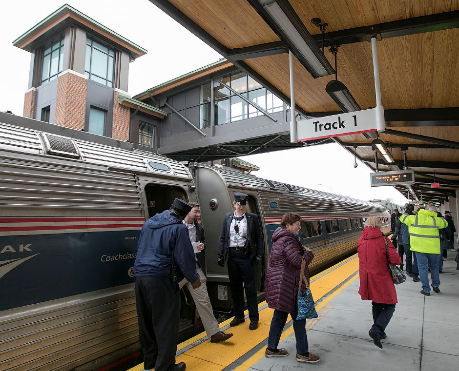 Passengers step off an Amtrak train at the Meriden train station, Thursday, April 19, 2018. State and city leaders crowded onto the platform at the new Meriden train station to cut the ribbon on the CTrail Hartford Line, which officials hope will provide an alternative option for commuters and potentially ease highway congestion. Dave Zajac, Record-Journal