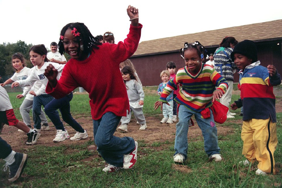 Chavonne Gibbons, age 7 from Meriden (center, in red) starts off the tot race with others at the Meriden YMCA 2nd Annual Triple Challenge Adventure Race held at the YMCA Outdoor Center Oct. 9, 1999.