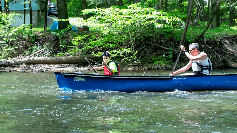 Theo Kenyon, 10, and his father Ted Kenyon canoe their way toward the finish line in the Quinnipiac Downriver Classic race on May 19, 2019. The yearly kayak and canoe race attracted 35 participants this year, going from the Meriden-Waterbury Turnpike to the Red Bridge on Oregon Road in Meriden. Devin Leith-Yessian/Record-Journal