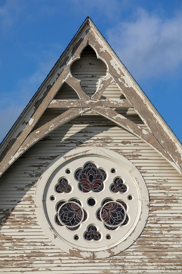 Paint scraped arch on the south side of Plantsville Congregational Church as renovations continue on the 1866 church, Tuesday, Oct. 9, 2018. Dave Zajac, Record-Journal
