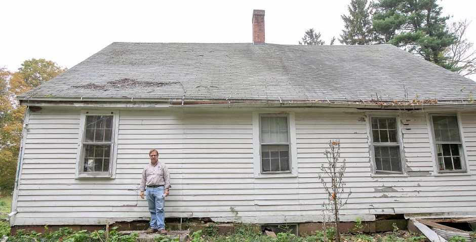 Local developer John Ricci stands where the original front door was located on the Nathaniel Ives house at 257 Fenn Rd. in Cheshire, Monday, Oct. 8, 2018. Ricci is owner of the house built around 1749 and is considering how to develop the 50-acre property. Dave Zajac, Record-Journal