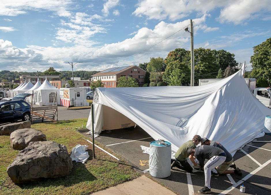 Workers for Durants Party Rentals set up a tent in preparation for this year