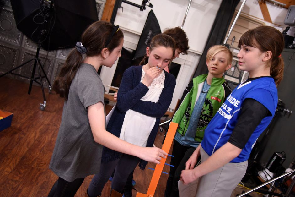 The Coginchaug Valley Educaiton Foundation Odyssey of the Mind team look at a broken prop piece on April 30, 2019 in Middlefield. The team will compete in the Odyssey of the Mind world competition in Michigan later this month. | Bailey Wright, Record-Journal