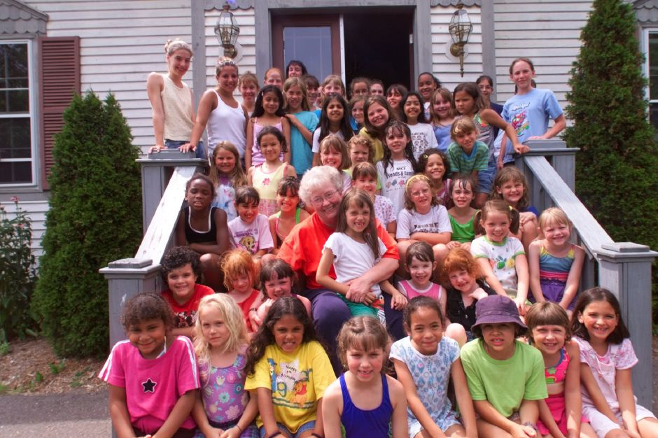 RJ file photo - Maureen Bilger, center, executive director of Girls Inc. will be retiring in the next year. These are her girls June 29, 1999. On her lap is Christina Ward, 7, of Meriden.