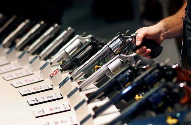 FILE - In this Jan. 19, 2016 file photo, handguns are displayed at the Smith & Wesson booth at the Shooting, Hunting and Outdoor Trade Show in Las Vegas. When gunmakers and dealers gather this week in Las Vegas for the industry