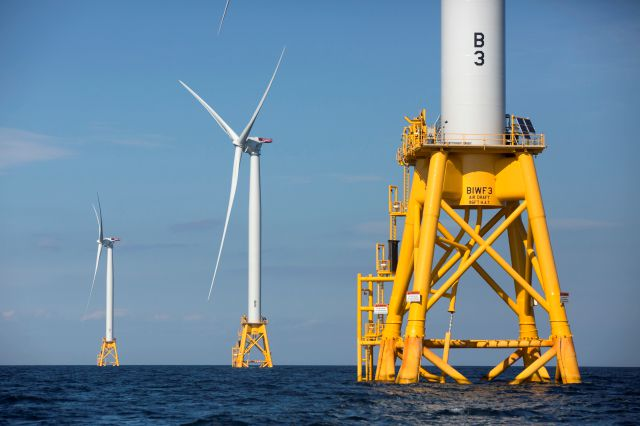 FILE - In this Aug. 15, 2016 file photo, three wind turbines from the Deepwater Wind project stand off Block Island, R.I. Deepwater Wind CEO Jeff Grybowski said Monday, July 16, 2018, they are beginning the next, larger phase of development for a wind farm to supply power to Rhode Island and Connecticut, another for Long Island, N.Y., and a third for Maryland