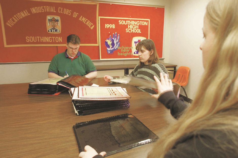 RJ file photo - Members of hte Vocational Industrial Clubs of America work on a scrapbook at Southington High School, March 1999. They will enter the book into a statewide competition. From left, John Royer, 19, of Southington, Jessica Spranovich, 16, of Bristol and Anne Trudel, 15, of Bristol.