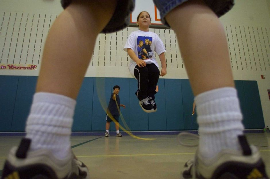 RJ file photo - Marie Rodriguez, 9, a third-grader at Yalesville School, gets some air time while jumping rope. Swinging the rope are Michael Walsh, 9, foreground, and James Comeau, 9, back, May 1999.