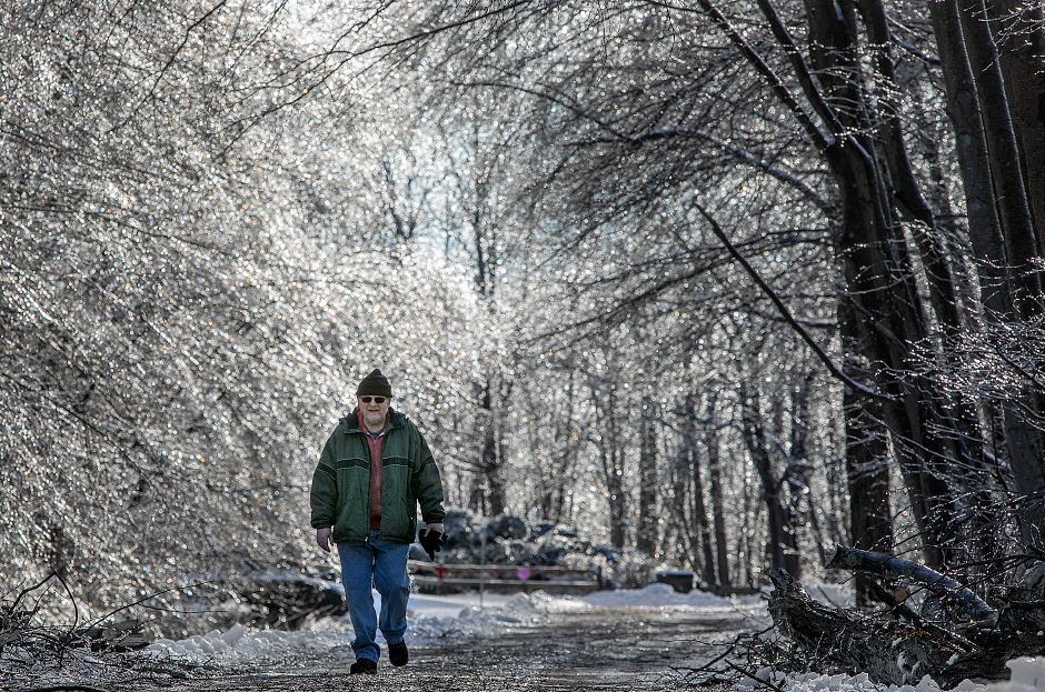Paul Kostes, of Naugatuck, walks a path through a crystal forest  at Lock 12 Historical Park in Cheshire on Tuesday.
