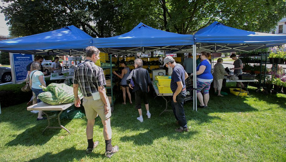 The Gresczyk Farms of New Hartford stand attracted early shoppers at the Farmer