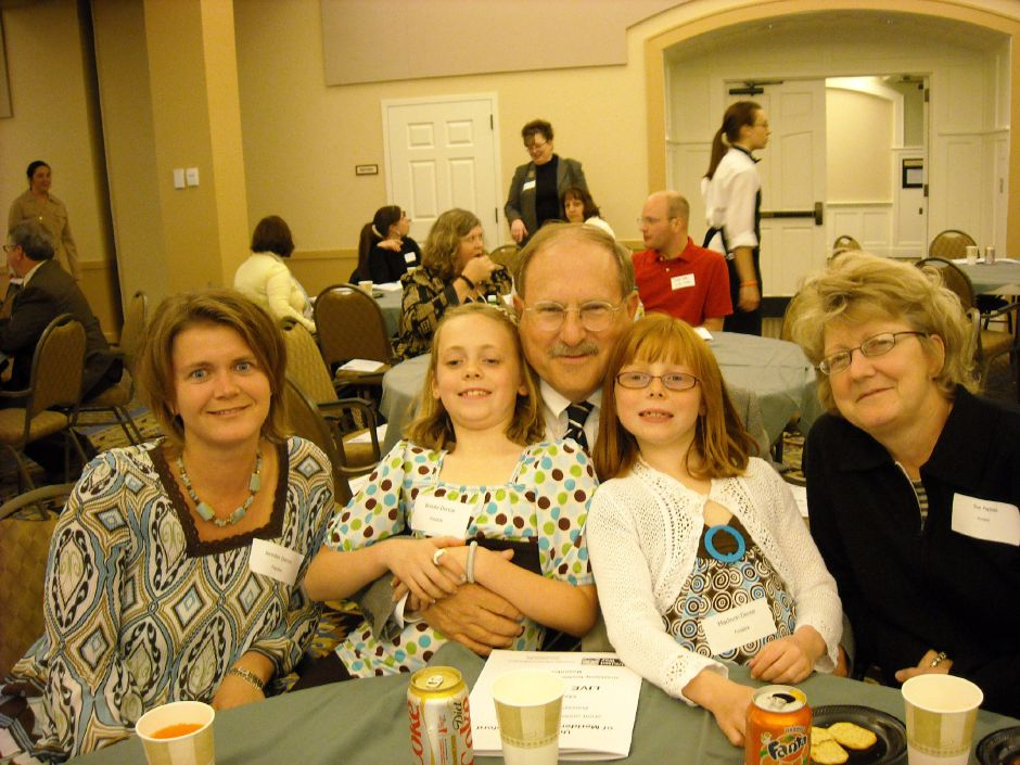William Pappas sits wiith, from left, his daughter, Jennifer Denne,  grandaughters, Brooke Denne and Madison Denne,  and wife, Susan Pappas. Courtesy of the United Way