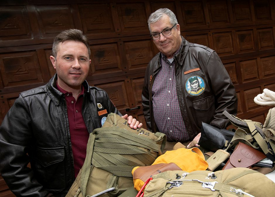 Matt Jalowiec, left, and Jerry O'Neill, of Cheshire, pose with combat jump gear at Jalowiec