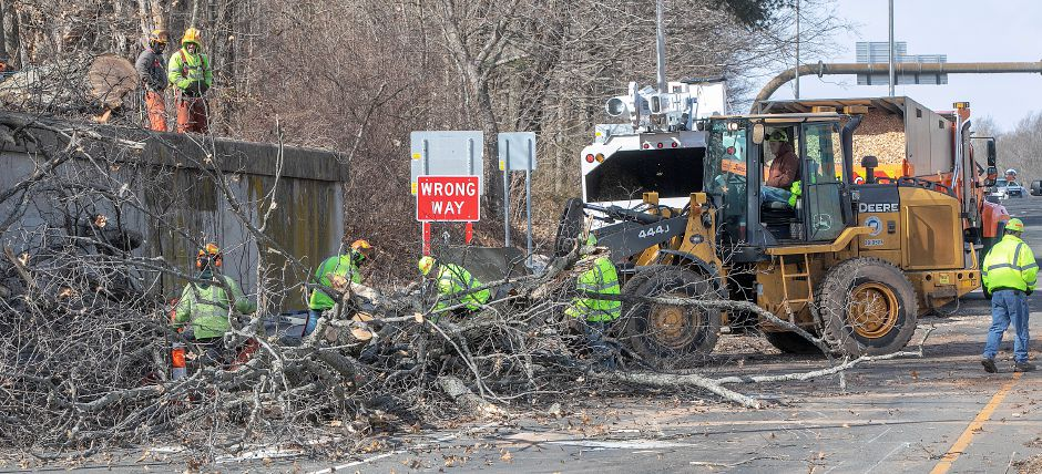 State DOT crews work to remove a large tree fallen over the Interstate 84 West exit 30 ramp in Southington Monday. See story and photos on A3 and at myrecordjournal.com. Dave Zajac, Record-Journal