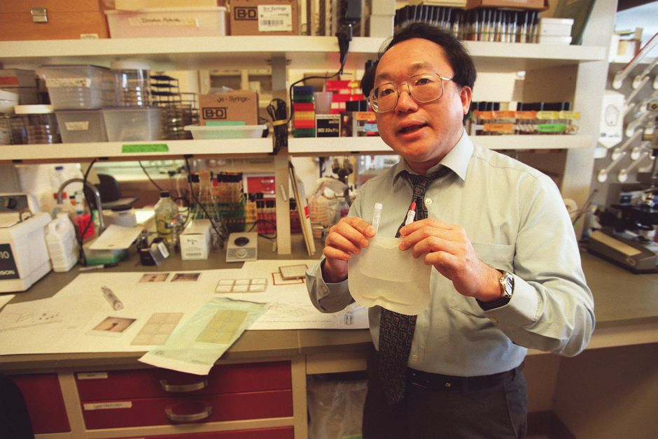 RJ file photo - Bristol-Myers Squibb Scientist Dr. Ray Lam holds a bag containing media that will be used to grow bacteria aboard the space shuttle Discovery, Oct, 29, 1998.