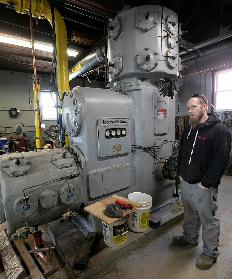 Shane Riley, snow-making supervisor, talks about a 1952 reciprocating compressor, a key component in snow-making at Mount Southington, Thurs., Nov. 29, 2018. Dave Zajac, Record-Journal