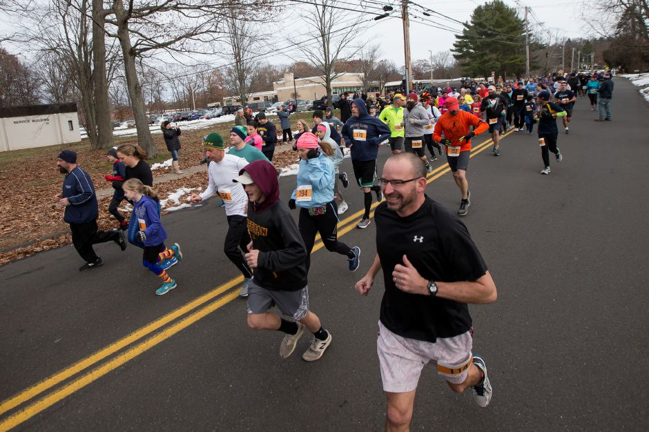 Runners in the 5K and 5 mile leave the starting line Sunday during the Kiwanis Turkey Trot 5k and 5 mile at Stephens School in Wallingford November 18, 2018 | Justin Weekes / Special to the Record-Journal
