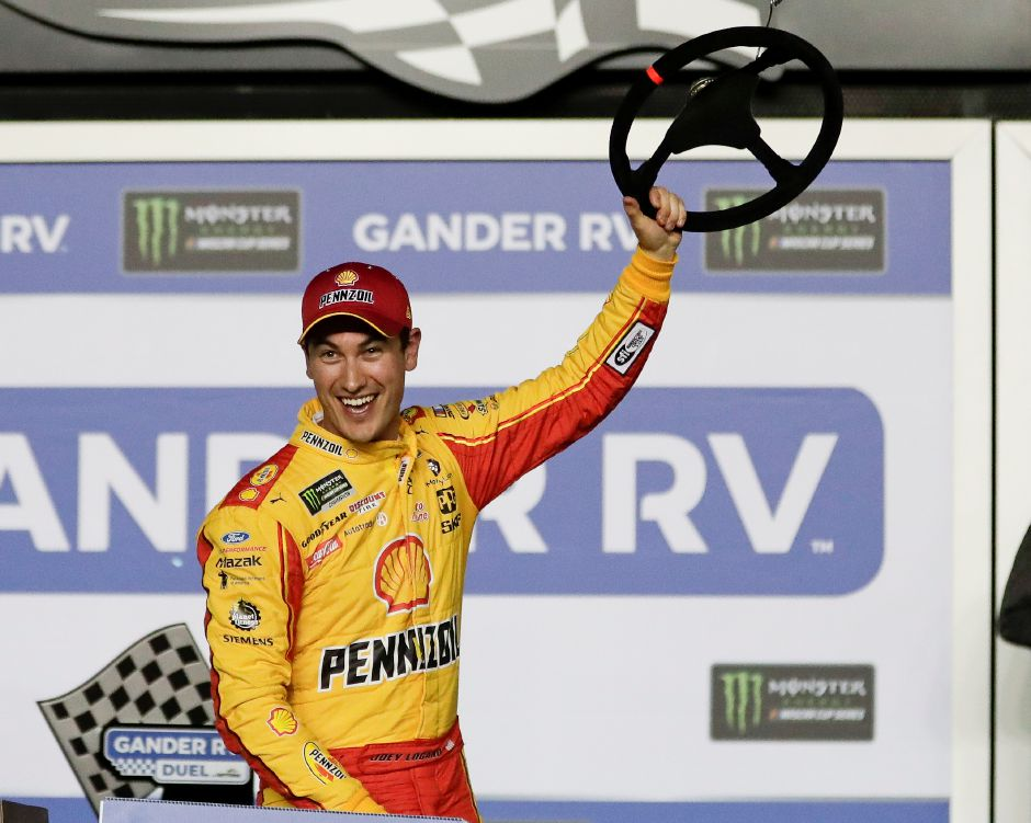 Joey Logano celebrates in Victory Lane after winning the second of two qualifying auto races for the NASCAR Daytona 500 at Daytona International Speedway, Thursday, Feb. 14, 2019, in Daytona Beach, Fla. (AP Photo/John Raoux)