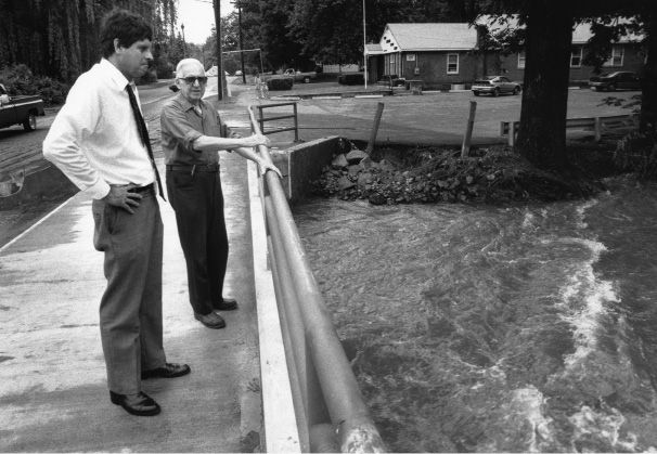 Buddy Altobello gets an earfull from Charles Petroske who lives on Bradley Avenue when he visited the flood damaged sites June 6, 1992.