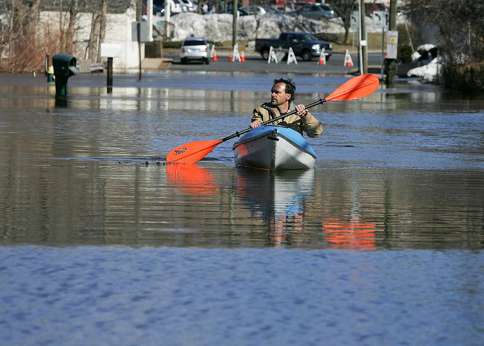 Kevin Jobbagy, of Southington, kayaks outside his home on Curtiss Street in Southington on Monday March 7, 2011. Heavy rains and melting snow caused the Quinnipiac River and a nearby brook to oversflow and shut down Curtiss Street. Jobbagy and other neighbors said flooding on the street hasn