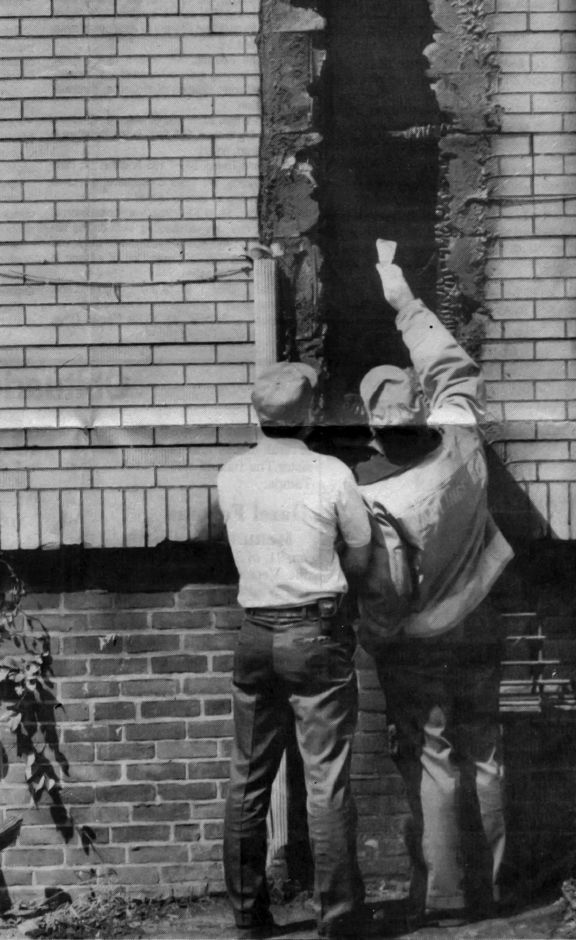 RJ file photo - Wallingford fire officials examine damage at the Hungarian Hall, Sept. 2, 1992. The scene of an apparent arson fire early Tuesday.